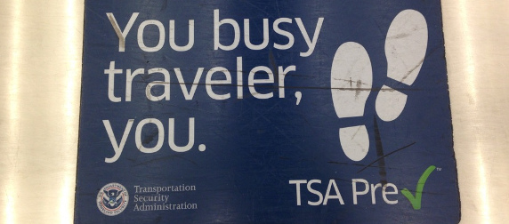 TSA PreCheck sign telling passengers they may leave their shoes on