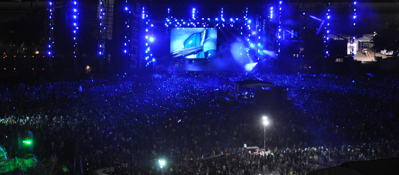 crowds in front of a lit stage at night at the Ultra Music Festival in 2011