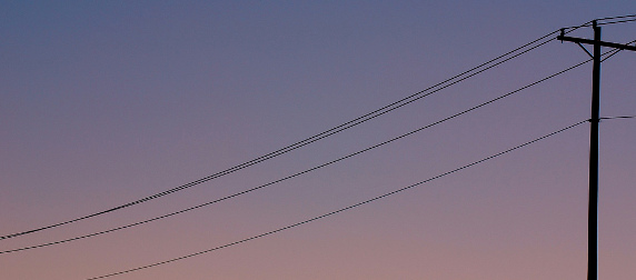 telephone lines against a sky at sunset