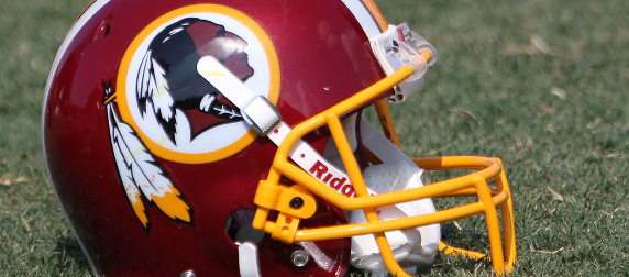Washington Redskins helmet sitting on grass