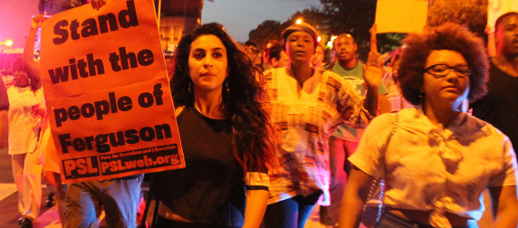 protesters marching with pro Ferguson signs in Washington, D.C.