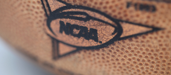 detail of NCAA logo on a football
