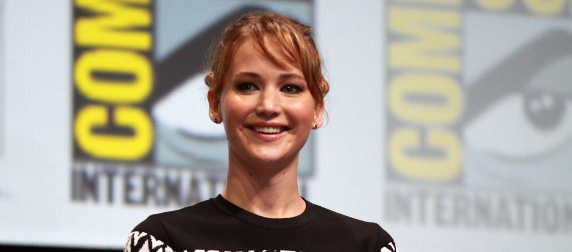 Jennifer Lawrence in front of a San Diego Comic Con banner