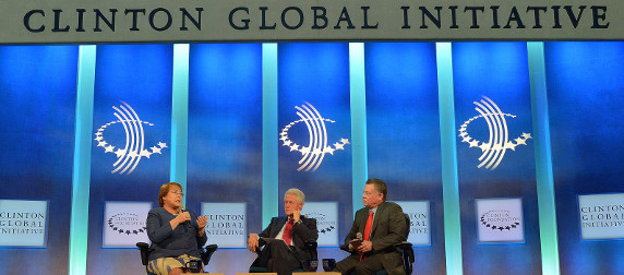 Michelle Bachelet, Bill Clinton and Abdullah II ibn Al Husseib speaking on stage at the Clinton Global Initiative