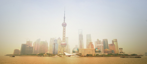 The Pudong, Shanghai, skyline viewed at a distance through smog