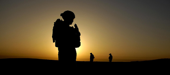 sillouhette of an Iraq War soldier against a sunset