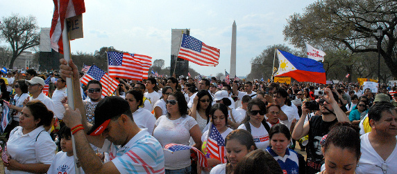 immigration reform demonstrators with flags on the National Mall