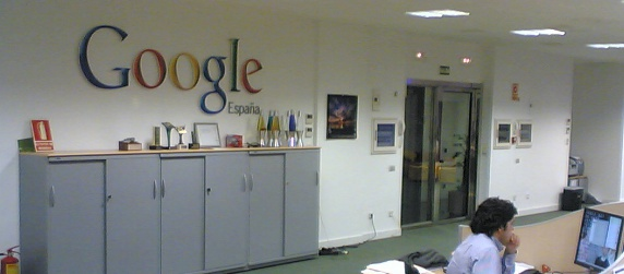 Google Spain office sign, with a worker, three-quarter view