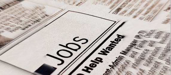newspaper column with a Jobs heading and Help Wanted subhead, blurred edges