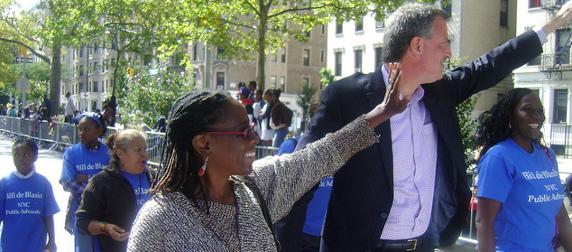Chirlane McCray and Bill de Blasio waving to supporters