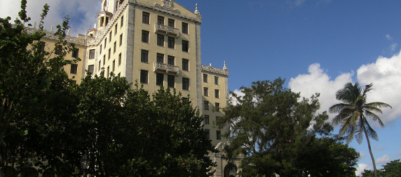 facade of the National Hotel of Cuba rising among trees against a blue sky