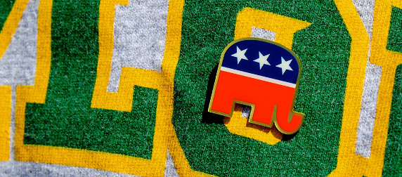 close-up of a Republican elephant pin on a t-shirt