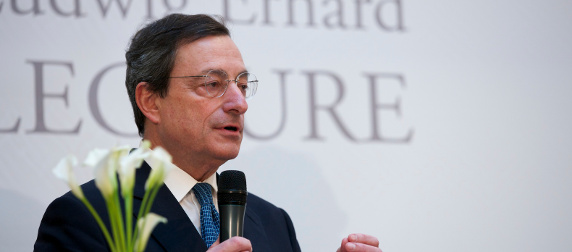 ECB Chariman Mario Draghi speaking with a microphone