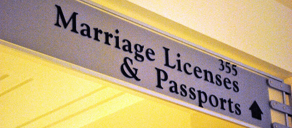 Sign reading 355 Marriage Licenses & Passports
