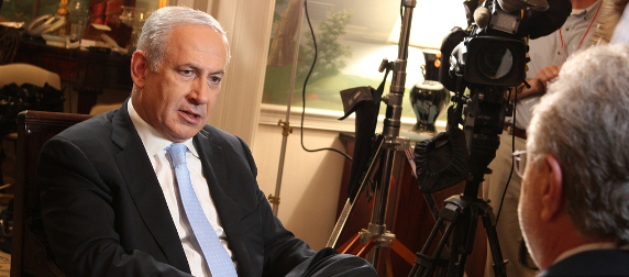 Benjamin Netanyahu in the midst of filming a television interview with Wolf Blitzer