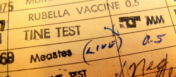 vaccination record, including rubella, a tine test, and measles