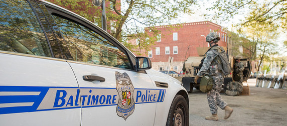 detail of a Baltimore police car and a National Guard soldier