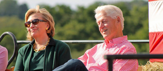 Bill and Hillary Clinton, in casual dress, smiling