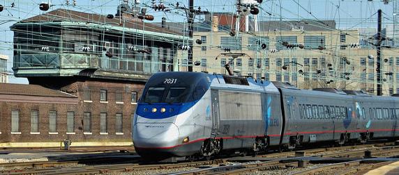 Amtrak Acela train arriving in Washington's union station under various power lines