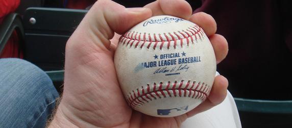 Major League Baseball in the hand of a fan who caught it, Wrigley Field