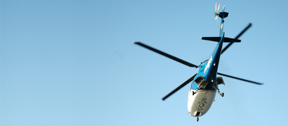 helicopter in flight against a blue sky