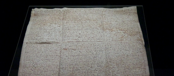 copy of the Magna Carta in a museum display