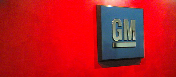 General Motors' logo displayed against a red background