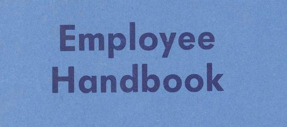 employee handbook title on blue paper
