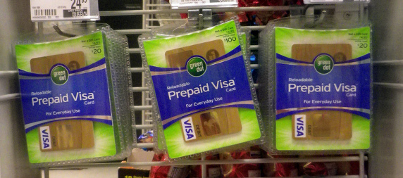 prepaid Visa debit cards hanging on a display for sale
