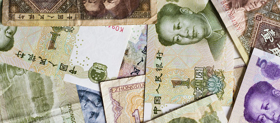 collection of yuan bills, arranged at random