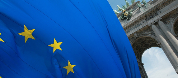 detail of the European Union flag, the Quadriga of Brabant in the background