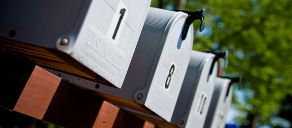 close view of a row of gray mailboxes