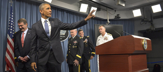 President Obama waving as he departs a press briefing at the Pentagon