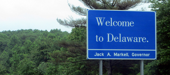 Welcome to Delaware interstate sign against forested background