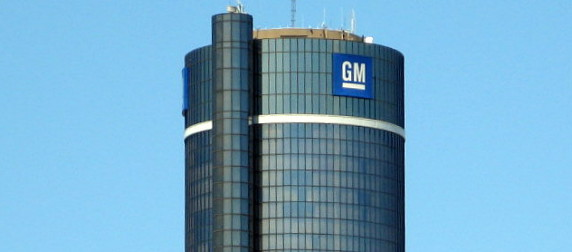 GM logo on a building against a blue sky