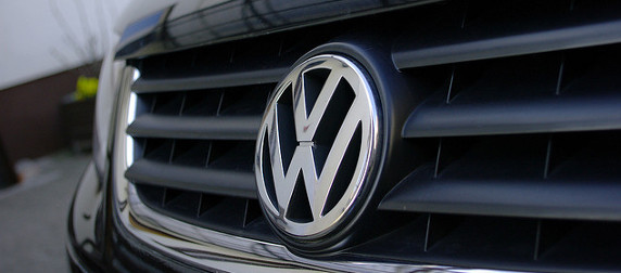 detail of a Volkswagen logo on a car's front grille
