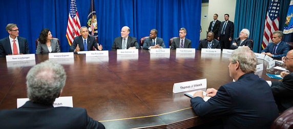 Barack Obama addressing agriculture and business leaders at a large oval table