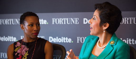 Anna Maria Chavez and Tiffany Dufu speaking in front of a black background reading Fortune and Deloitte