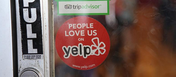 sticker on a door that reads 'People Love Us On Yelp' with the Yelp logo and web address