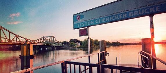 sign reading Station Glienicker Brucke in foreground, bridge in background