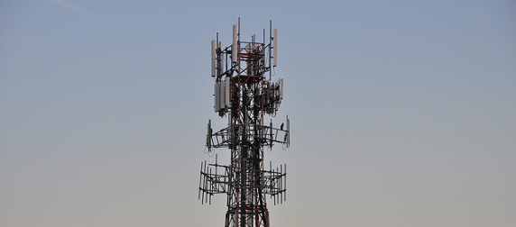 cell tower against a sunset