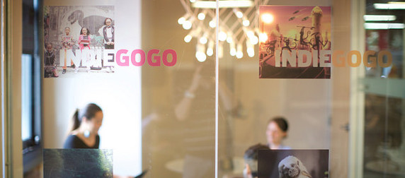 glass doors of IndieGoGo headquarters with people out of focus in the background