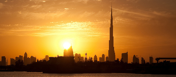 the Dubai skyline at sunset