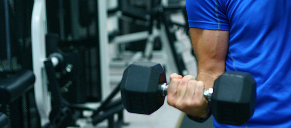 arm curling a dumbbell
