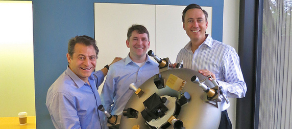 Peter Diamandis, Chris Lewicki and Steve Jurvetson holding a 3D-printed satellite prototype