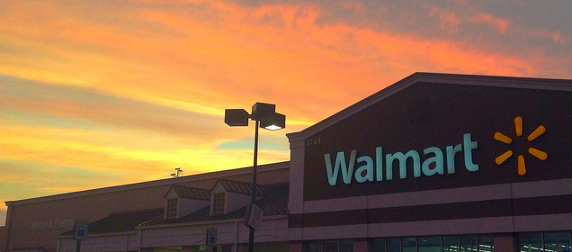 Wal-Mart storefront seen against a sunset sky