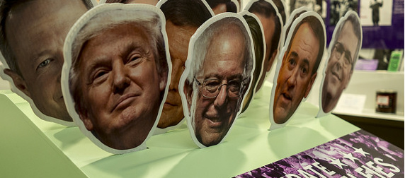 cutouts of the faces of various 2016 presidential candidates, prominently including Donald Trump and Bernie Sanders