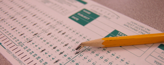 a broken pencil on top of a Scantron test form