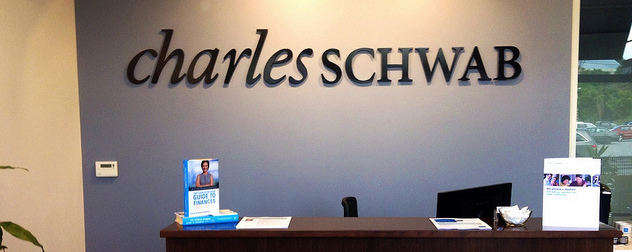 reception desk with Charles Schwab sign on the wall behind it