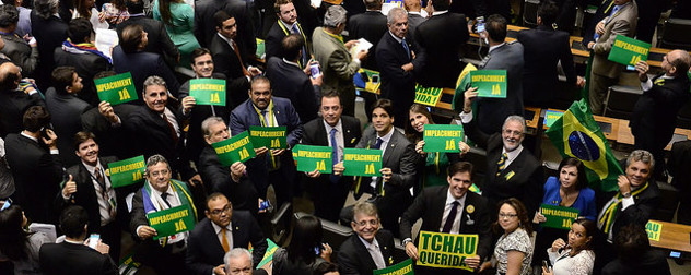 members of Brazil's Chamber of Deputies holding pro-impeachment signs on the Chamber floor